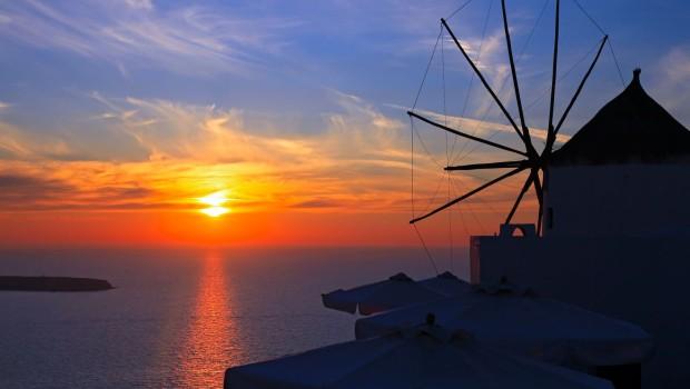 Windmill at sunset in Oia, Santorini island, Greece