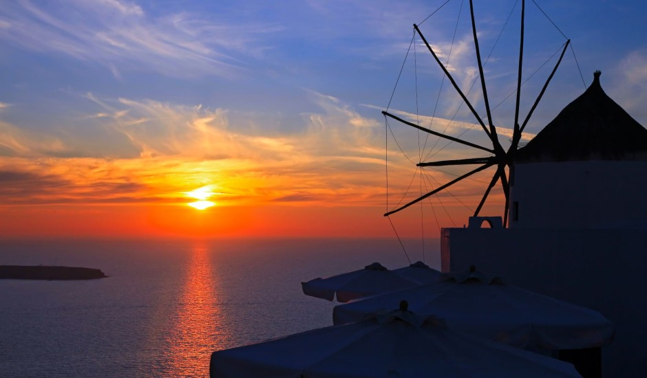 Windmill at sunset in Oia, Santorini island, Greece